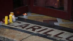 """Candles are seen on the entrance of the """"Le Carillon"""" bar and restaurant, in Paris, France, November 13, 2016, during a ceremony held for the victims of last year's Paris attacks which targeted the Bataclan concert hall as well as a series of bars"""