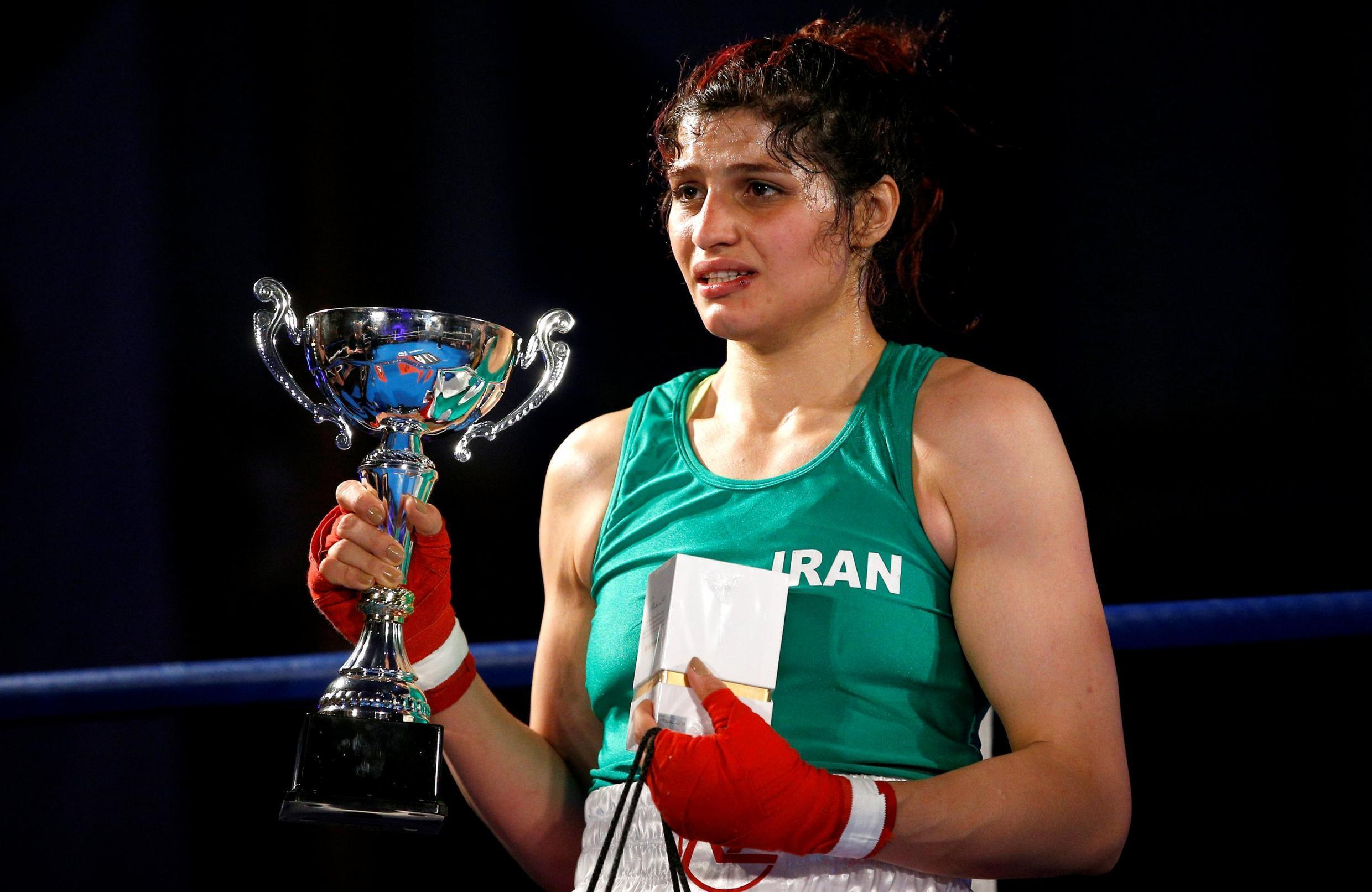 Iranian boxer Sadaf Khadem celebrates winning the fight against French boxer Anne Chauvin at the end of an official boxing bout in Royan, France, April 13, 2019.