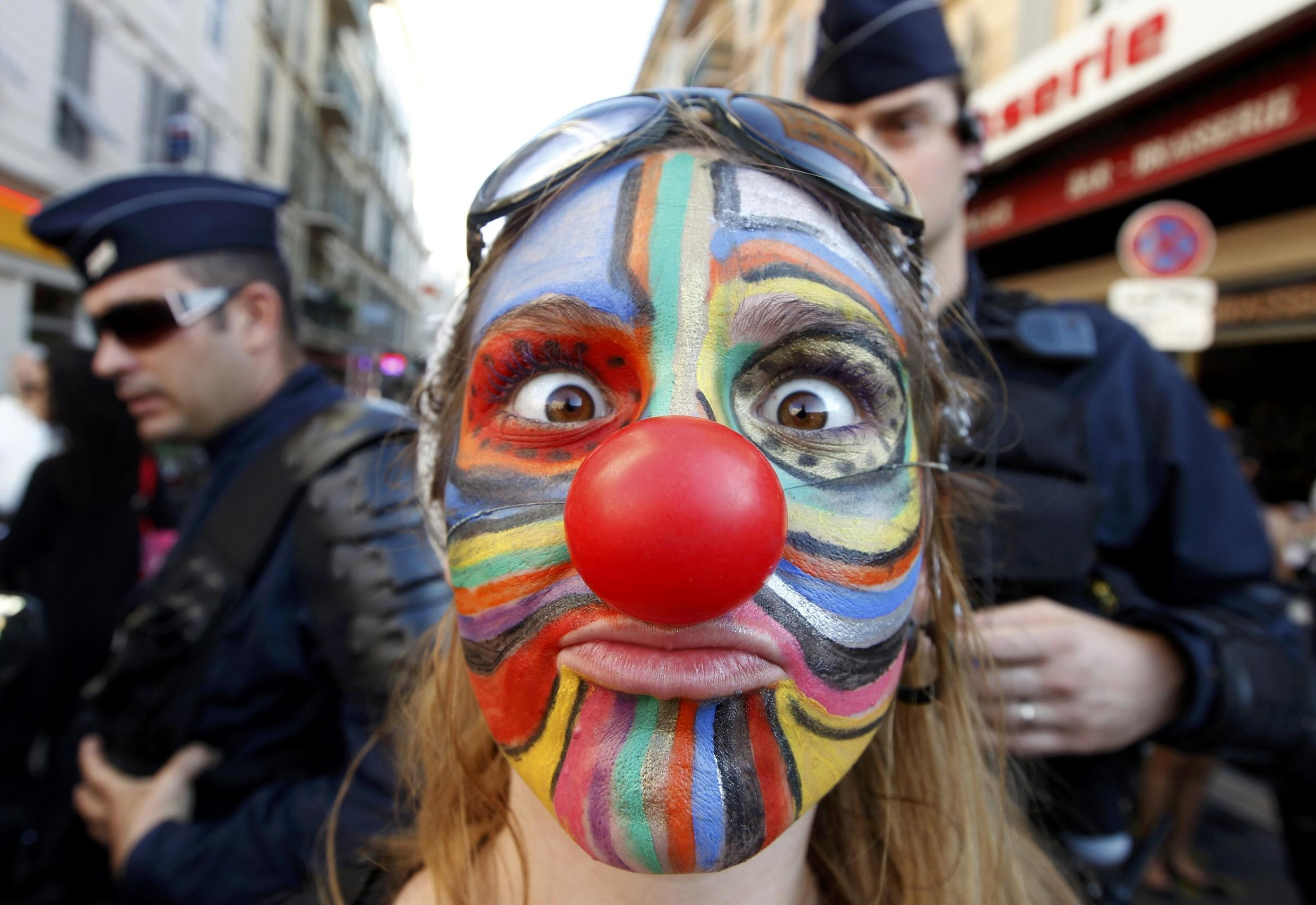 A demonstrator with a painted face during the Africa-France summit in Nice
