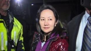 2018年12月11日,华为集团财务总管孟晚舟在加拿大温哥华法院出席保释听证会后离开。资料照片