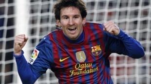 Dan kasar Argentina Lionel Messi dan wasan kungiyar Barcelona lokacin da yake murnan zira kwallo a raga