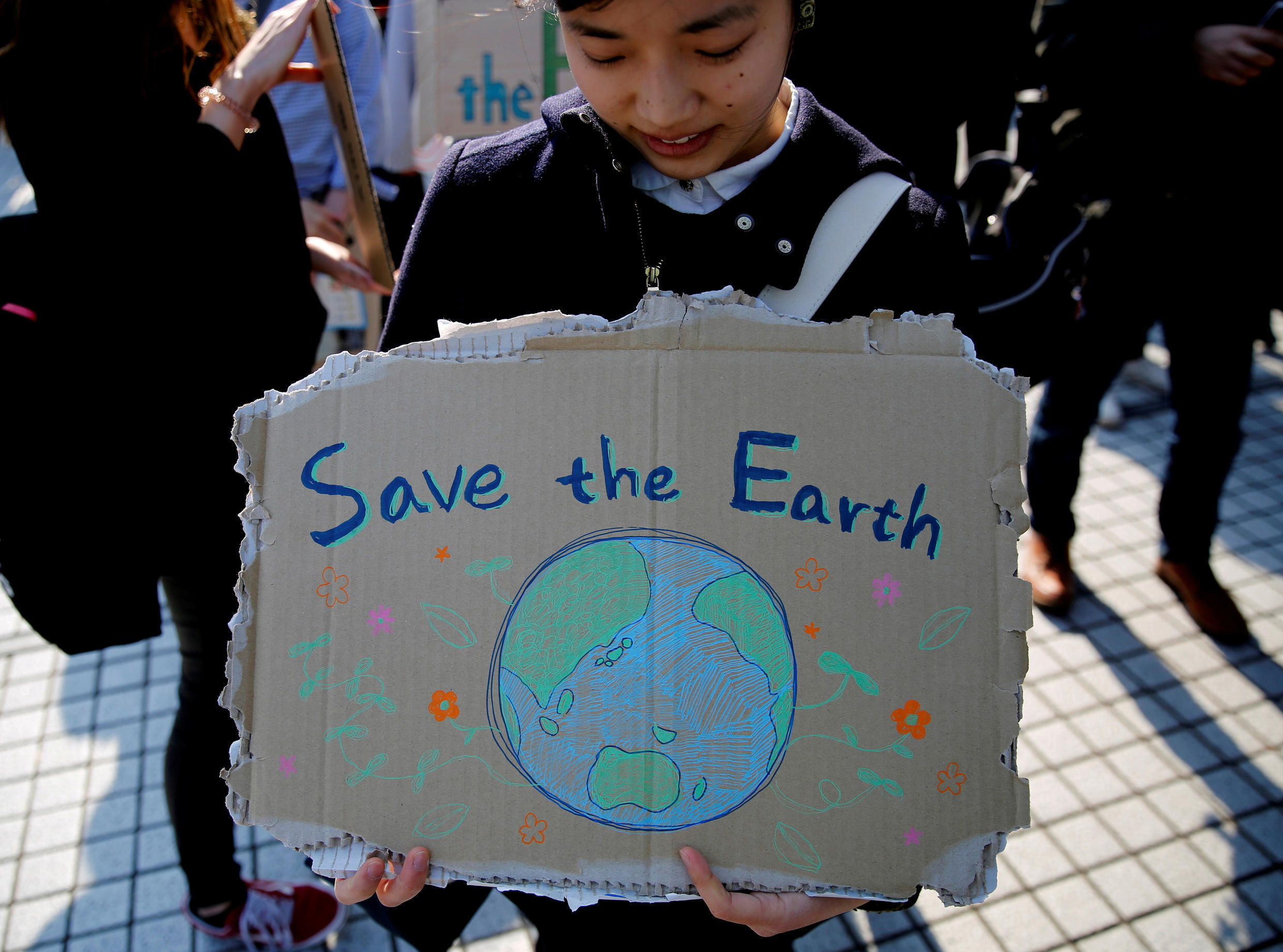 A student takes part in the global students strike for action on climate change in Tokyo, Japan.