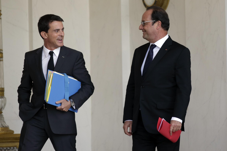 Манюэль Вальс (слева) и Франсуа Олланд