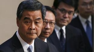 Hong Kong Chief Executive Leung Chun-ying and officials during a news conference in Hong Kong, 18 June