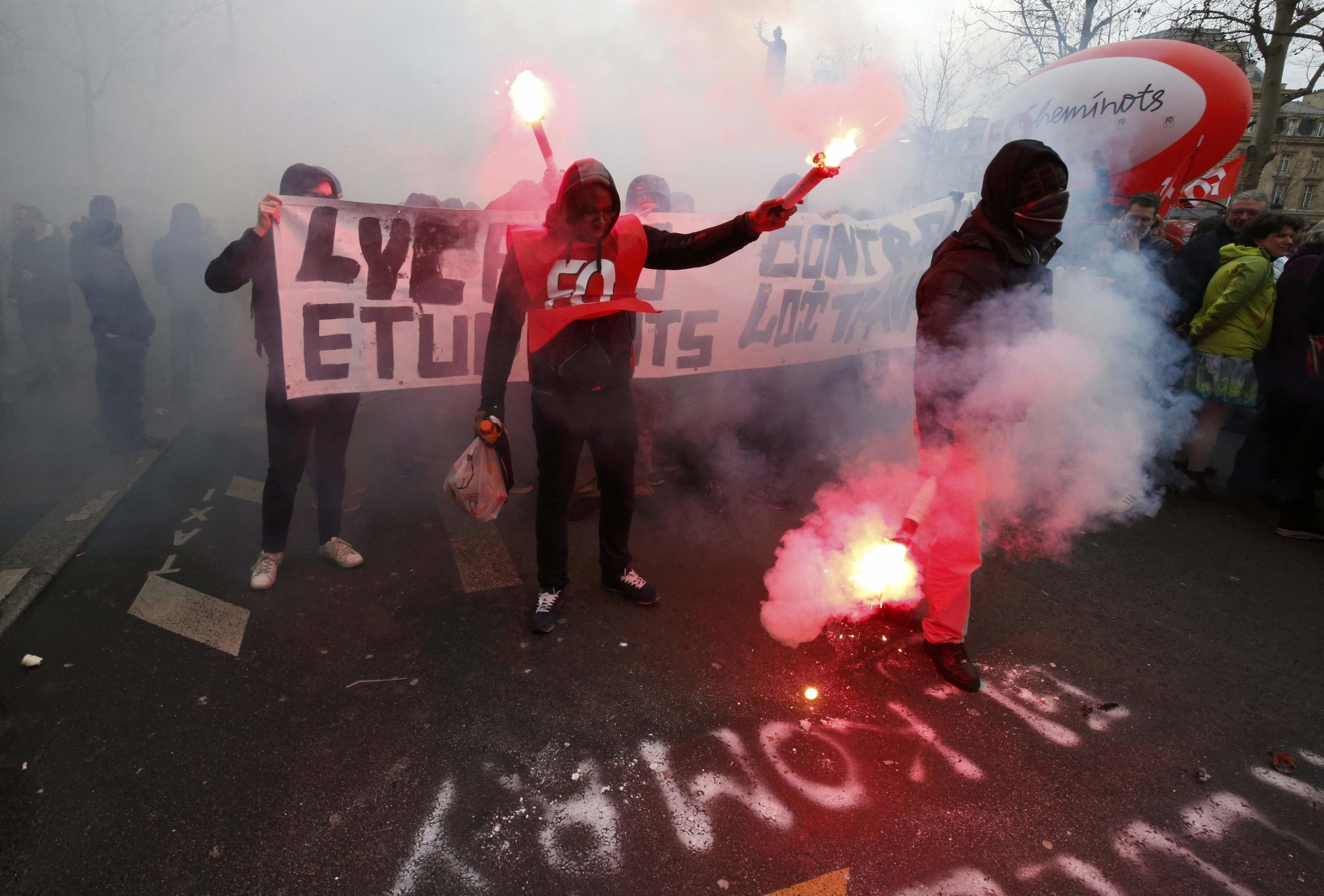 Students and school students join the protests against the labour bill in Paris on Wednesday