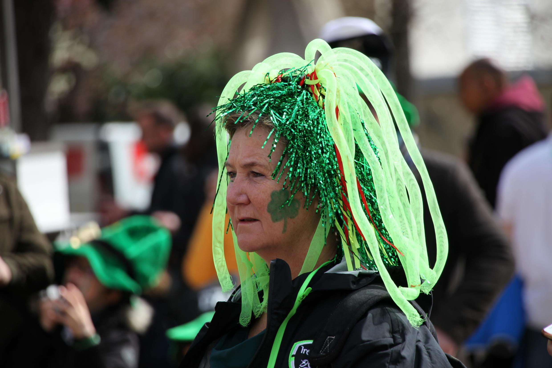A woman with a Saint Patrick hairdo.