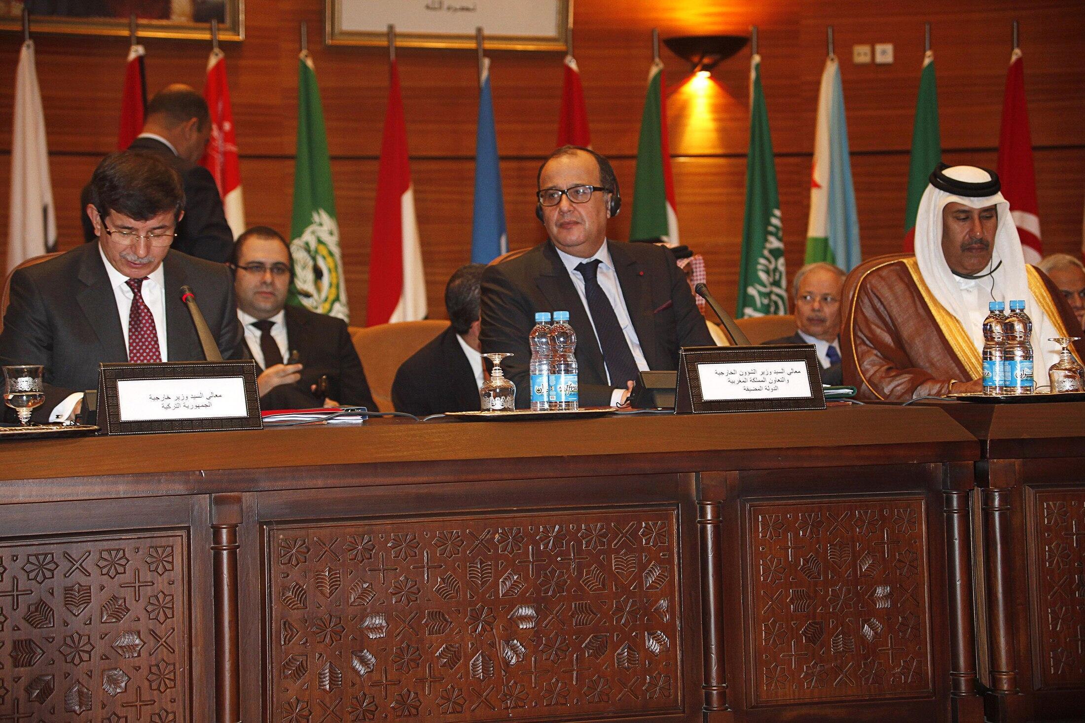 L to R: Turkey's Foreign Minister Ahmet Davutoglu, Moroccao's Taib Fassi Fihri and Qatar's FM Sheikh Hamad bin Jassim al-Thani i