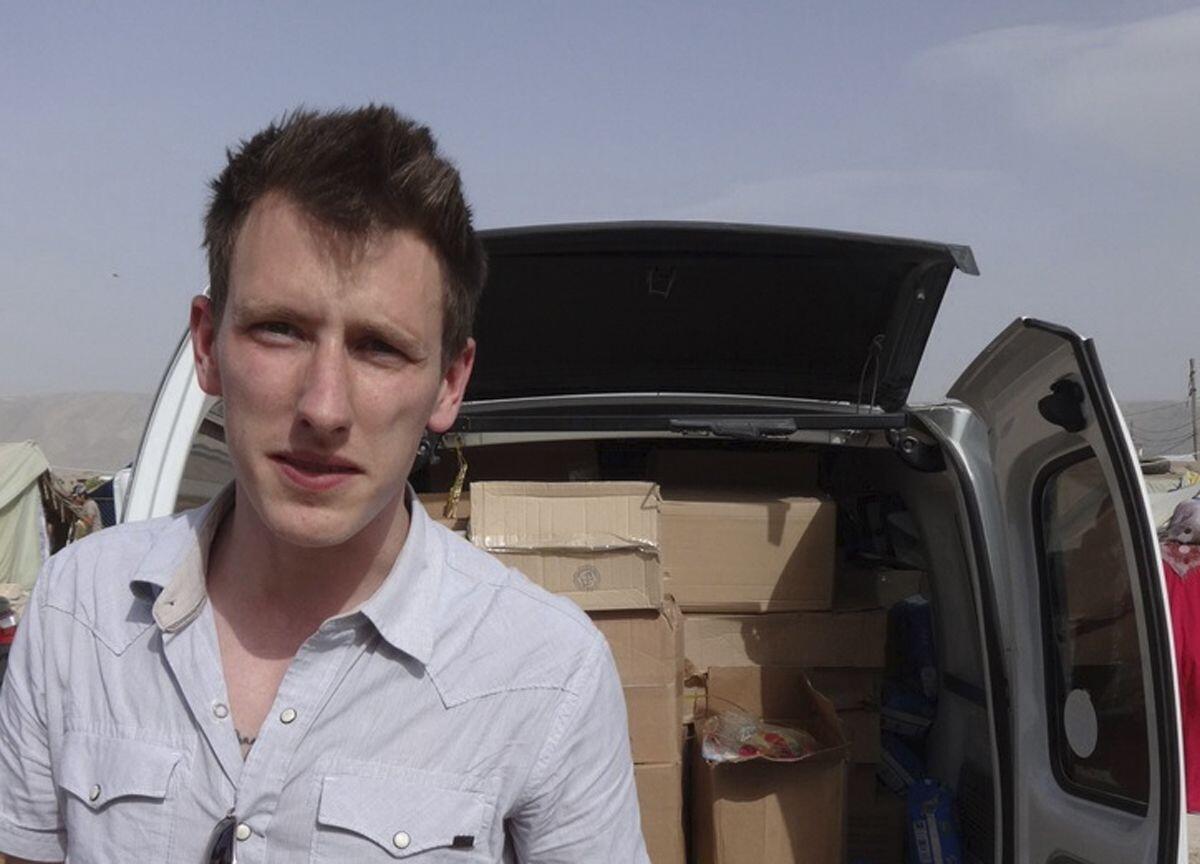 """Abdul-Rahman """"Peter"""" Kassig, em foto tirada durante a entrega de ajuda humanitária em maio de 2013."""