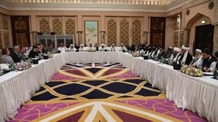 A handout picture released by the official Qatar's Ministry of Foreign Affairs shows the negotiating room with the US and Taliban delegations