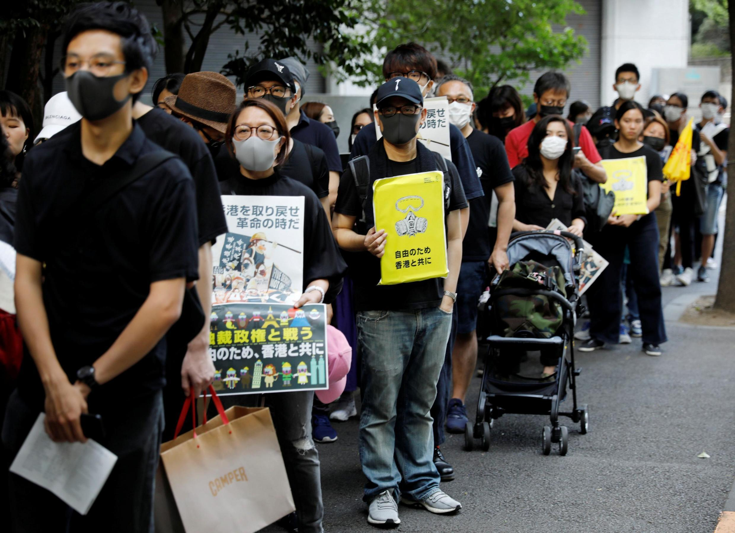 Protesters including Hong Kong people living in Tokyo, hold banners at a rally to support the pro-democracy movement in Hong Kong nearby Hong Kong Economic and Trade Office in Tokyo, Japan, September 29, 2019.
