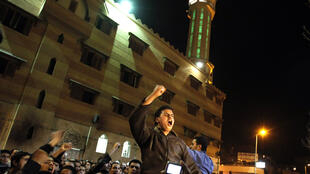 Coptic Christians demonstrate against Saturday's bomb attacks in front of the Sharq al-Madina mosque in Alexandria