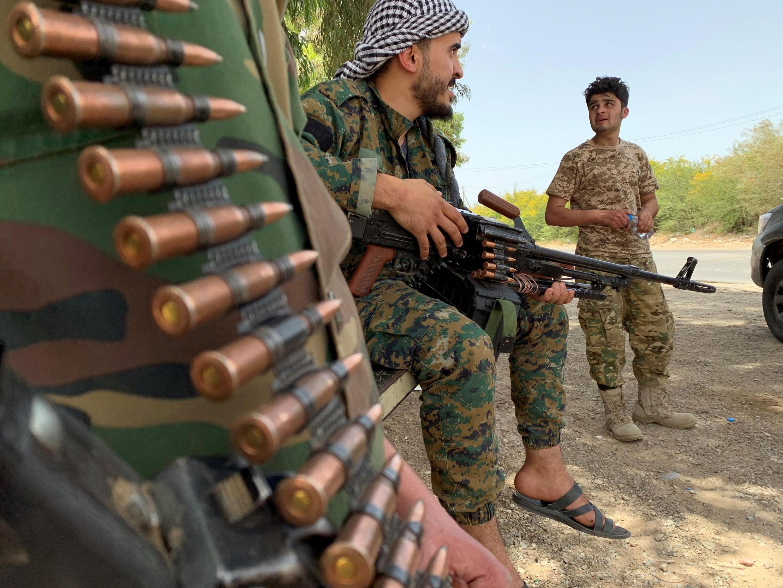 Des combattants fidèles au Gouvernement d'union nationale après avoir repris contrôle de Tripoli, le 4 juin 2020.