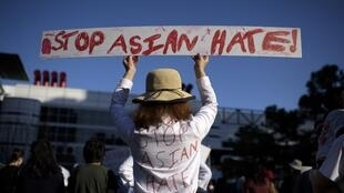 A protestor holds up a sign during a Stop Asian Hate rally at Discovery Green in Houston, Texas on 20 March, 2021. (Illustration photo)