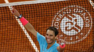 Champion: Rafael Nadal celebrates beating Novak Djokovic in last year's men's final