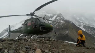 A helicopter leaves on January 27 to rescue two climbers on Nanga Parbat mountain.