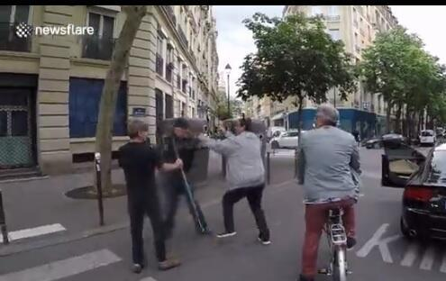 Screengrab of the alleged assault by a driver on the assistant of a blind man crossing road in Paris.