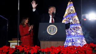 Le président des Etats-Unis, Donald Trump, et sa compagne Melania, le 30 novembre 2017 à Washington au moment d'allumer le sapin de Noël de la Maison Blanche.