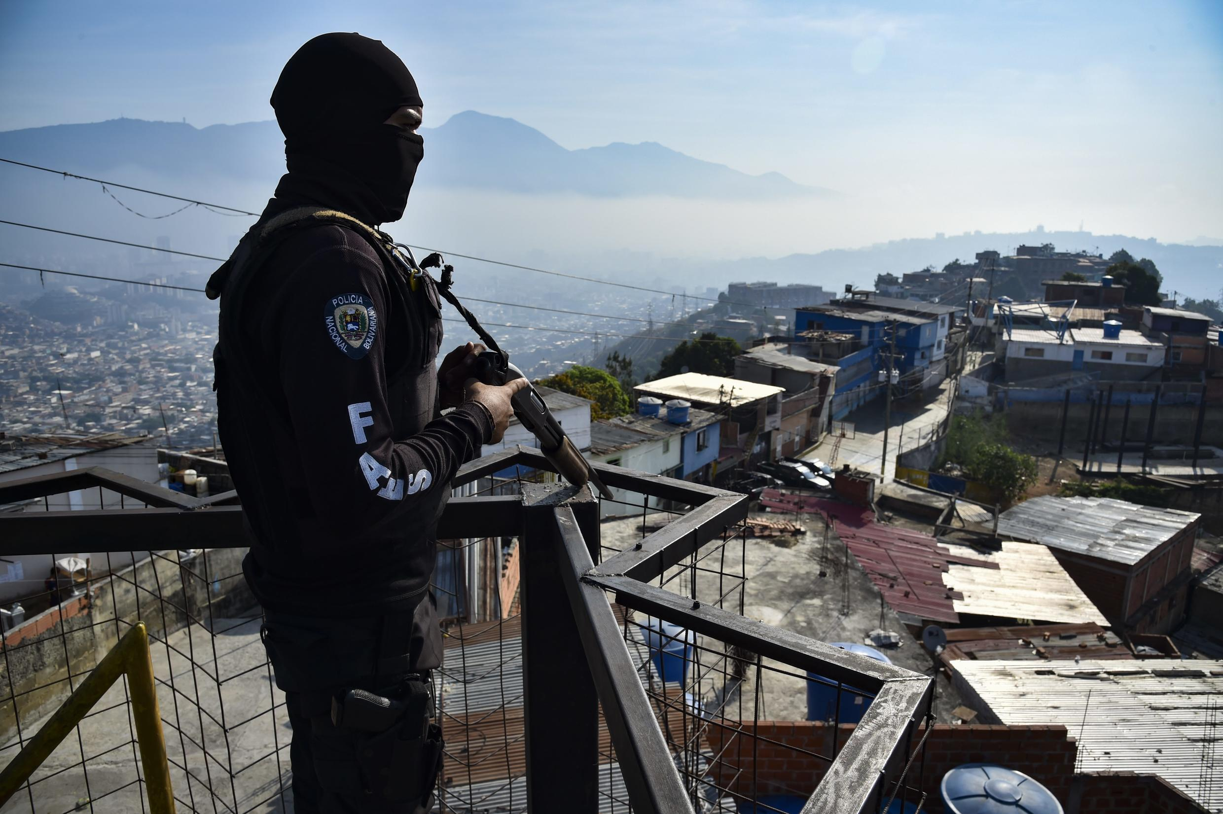 A member of Venezuela's special forces stands guard during a police operation in a Caracas neighborhood in April 2019