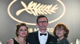 """Anne Wiazemsky, left, at the Cannes film festival in May for a screening of """"Le Redoutable"""", alongside its director Michel Hazanavicius and producer Florence Gastaud."""