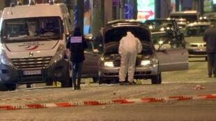 A still image from video footage shows Police investigators inspecting the car used by the attacker on the Champs Elysees Avenue after two policemen were killed and another wounded in a shooting incident in Paris, France.