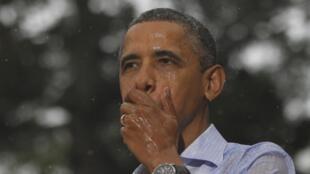 Barack Obama bajo la lluvia en el Estado de Virginia, el 14 de julio de 2012.