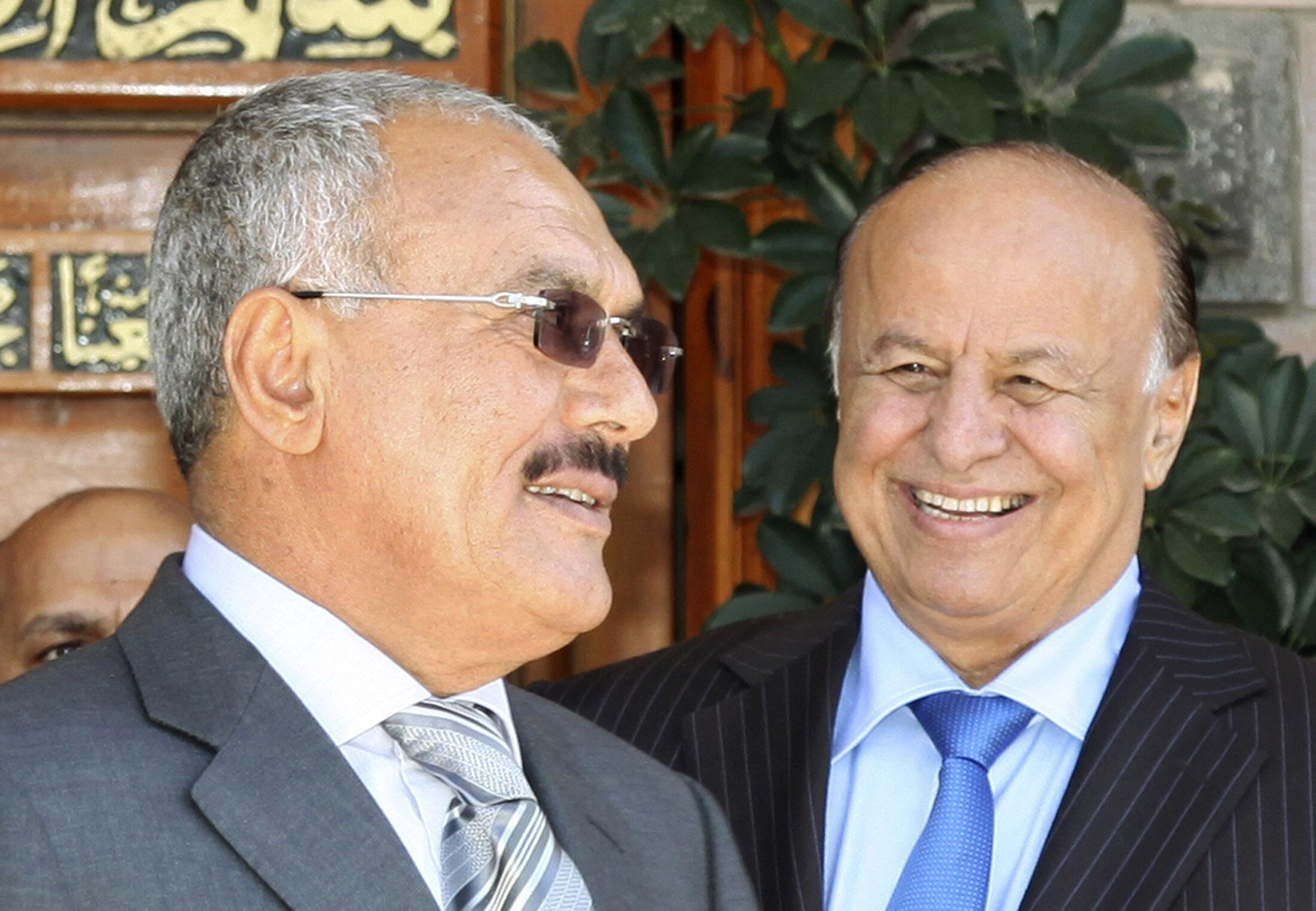 Yemen's President Ali Abdullah Saleh (L) and Vice President Abd-Rabbu Mansour Hadi smile at the Presidential Palace in Sanaa February 9, 2011.