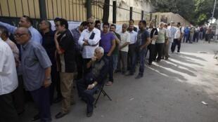 Cola de espera para votar, este miércoles 23 de mayo de 2012 en El Cairo.