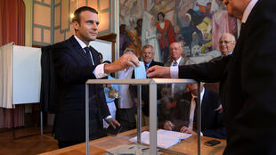 French President Emmanuel Macron casts his vote on Sunday