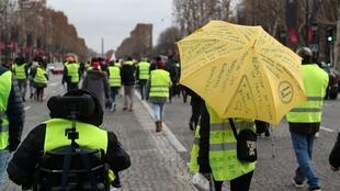 Protesters march on Paris' Champs-Elysées for 'Act VI' of France's Yellow Vest movement