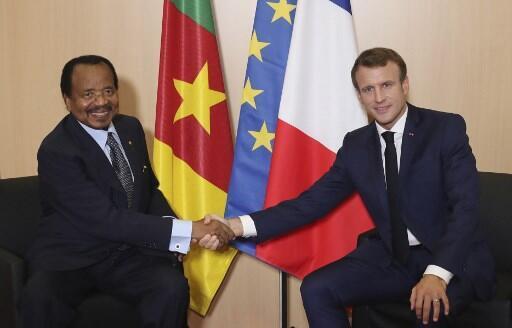 O Presidente camaronês Paul Biya (esquerda) e o Presidente francês Emmanuel Macron (direita), juntos em Lyon, a 10 de outubro de 2019.