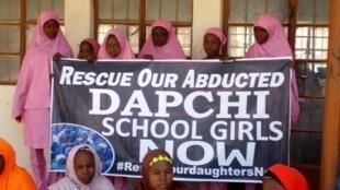 Schoolgirls await the arrival of Nigeria's President Muhammadu Buhari in Dapchi, Nigeria 14 March 2018