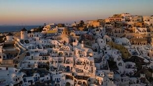 Sunset in the town of Oia on the island of Santorini as Greece prepares for the return of tourists