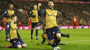 Olivier Giroud celebrates scoring the third goal for Arsenal against Liverpool at Anfield on Tuesday.