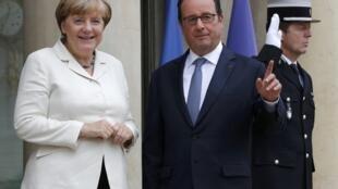 Francois Hollande recebeu hoje Angela Merkel no Eliseu.