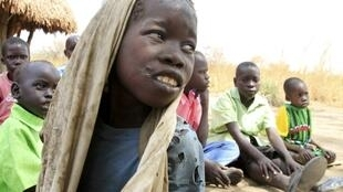 Okello Reagan, 11, who is suffering from nodding syndrome, sits with his peers in Akoya-Lamin Omony village in Gulu district