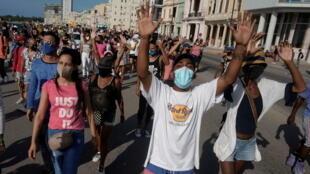 2021-07-12T010746Z_1178253737_RC2PIO9MM4NO_RTRMADP_3_CUBA-PROTEST (1)