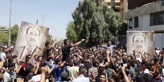 Сторонник премьер-министра Нури аль-Малики вышли на улицы Багдада, 11 августа, 2014 г.