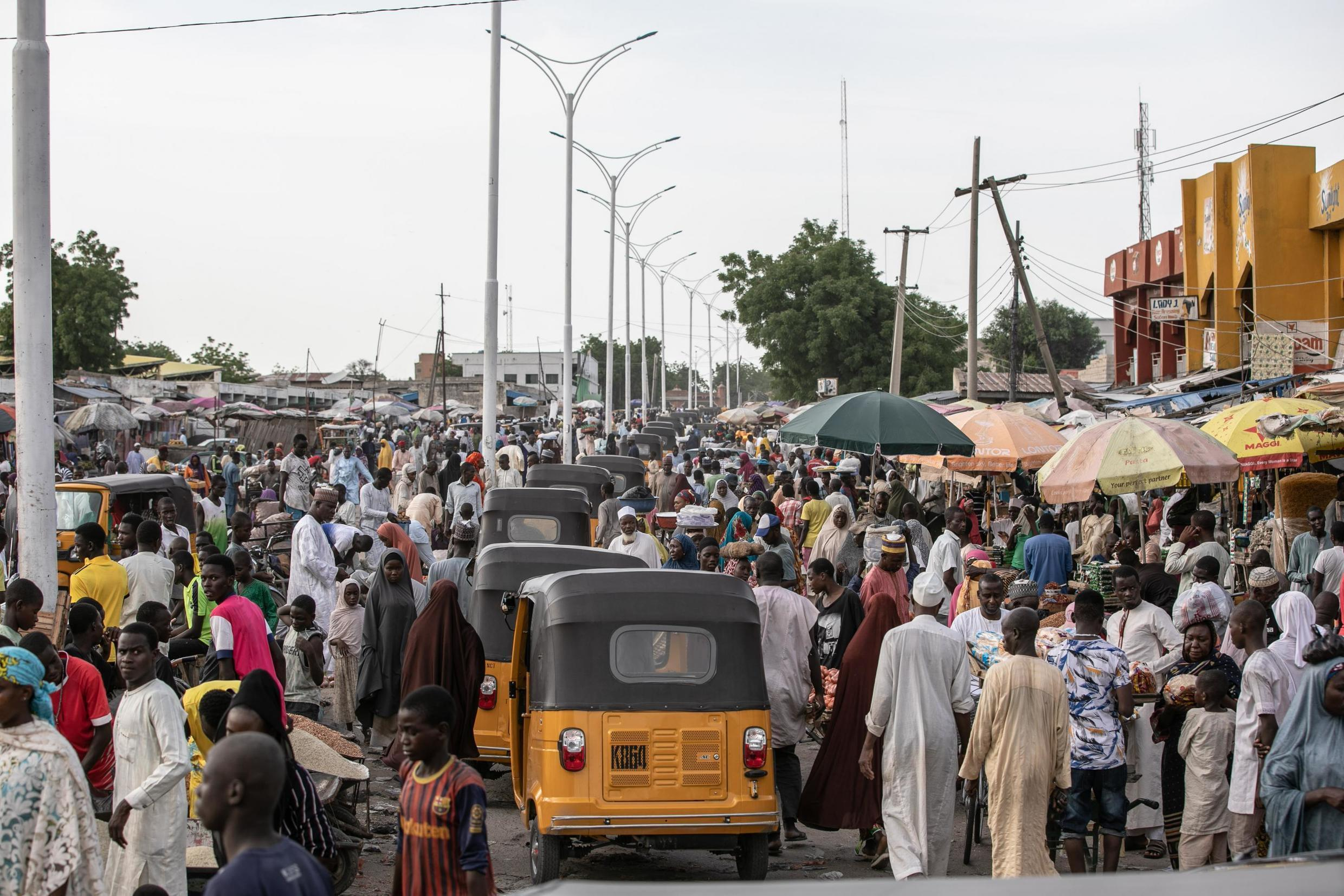 The hustle and bustle of Monday Market, one of the largest markets in Maiduguri which has endured several attacks by suicide bombers sent by Boko Haram but continues to thrive despite constant threat of attacks. 26th July, 2019.