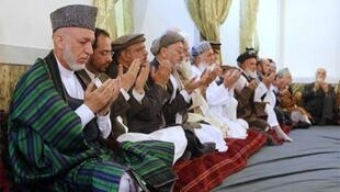 President Hamid Karzai at the official funeral of Burhanuddin Rabbani