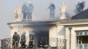 Firemen inspect the damage after a fire at the 17th century Hotel Lambert in the Ile Saint Louis in Paris, 10 July 2013
