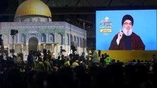 Le leader du Hezbollah libanais, Hassan Nasrallah, s'est adressé à ses partisans via un écran lors d'un rassemblement célébrant la Journée al-Qods (Jour de Jérusalem) à Beyrouth, le 31 mai 2019.