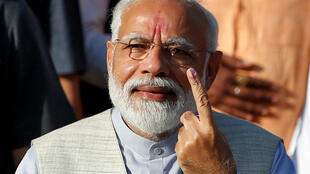 Indian Prime Minister Narendra Modi holding his finger skywards after having voted in India's marathon election in Ahmedabad, Gujarat, 23 April 2019.
