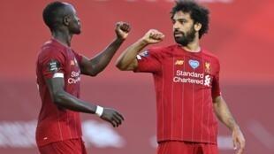 Le Sénégalais Sadio Mané et l'Égyptien Mohamed Salah, grands artisans du premier titre de champion d'Angleterre de Liverpool depuis 1990.
