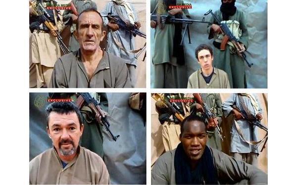 Заложники Даниель Ларриб, Пьер Легран, Марк Фере и Тьери Доль в плену АКИМ в Сахеле (архив)