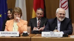 O ministro persa das Relações Exteriores, Mohammad Javad Zarif, participará de um jantar com a Chefe da diplomacia da UE, Catherine Ashton onde discutirão programa nuclear iraniano. Na foto encontro em Viena, 19 de março de 2014.