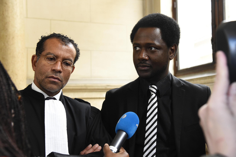 Victim Souleymane Sylla with his lawyer Jim Michel-Gabriel on Tuesday