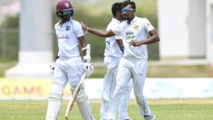 Sri Lanka's Suranga Lakmal (R) congratulates the West Indies' Kraigg Brathwaite (L) during the second Test