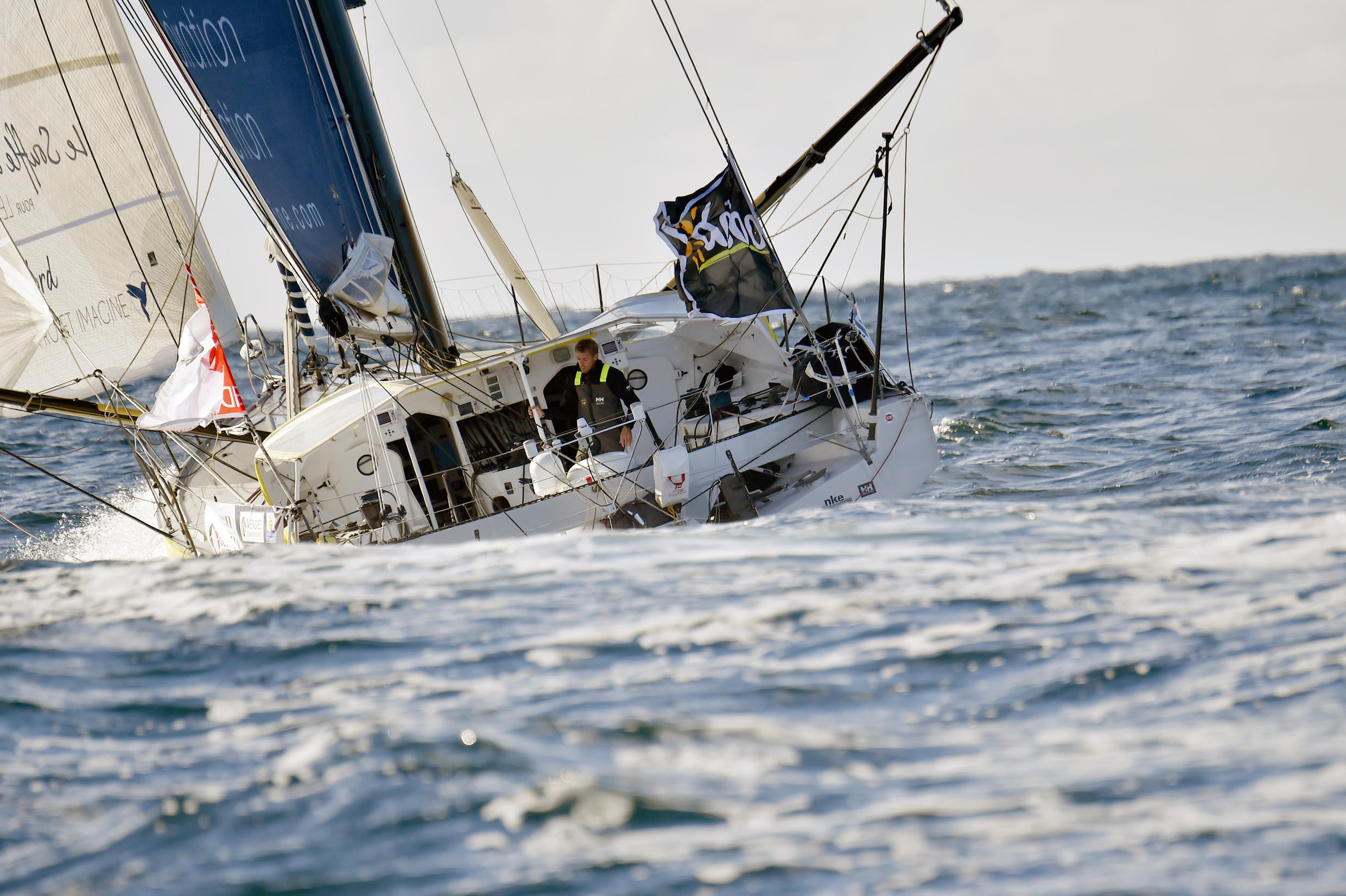 """French skipper Thomas Ruyant sails in his Imoca monohull """"Le souffle du nord """" the start of the Vendee Globe around-the-world solo sailing race, on 6 of November 2016 off les Sables d'Olonne."""
