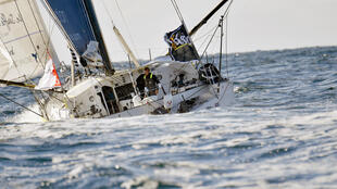 "French skipper Thomas Ruyant sails in his Imoca monohull ""Le souffle du nord "" the start of the Vendee Globe around-the-world solo sailing race, on 6 of November 2016 off les Sables d'Olonne."