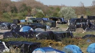 "Makeshift tent village in Calais, called ""the jungle"", 30 April 2015."